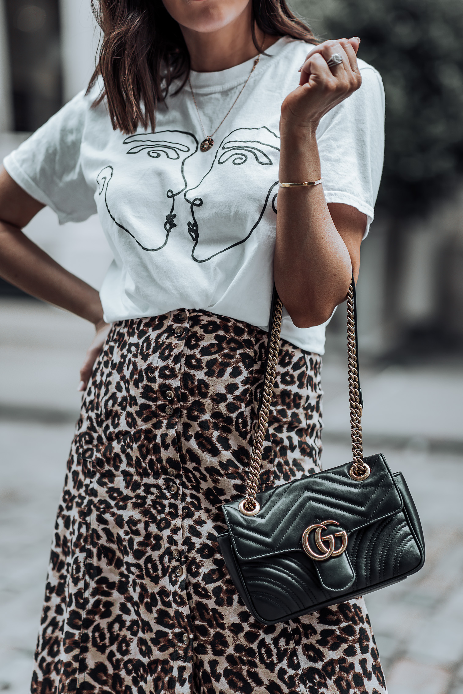 Leopard is the new black  Graphic Tee   Urban Outfitters Leopard Skirt   Gucci Bag   Greats Sneakers   #liketkit #leopard #minimalist #sneakeroutfits #streetstyle