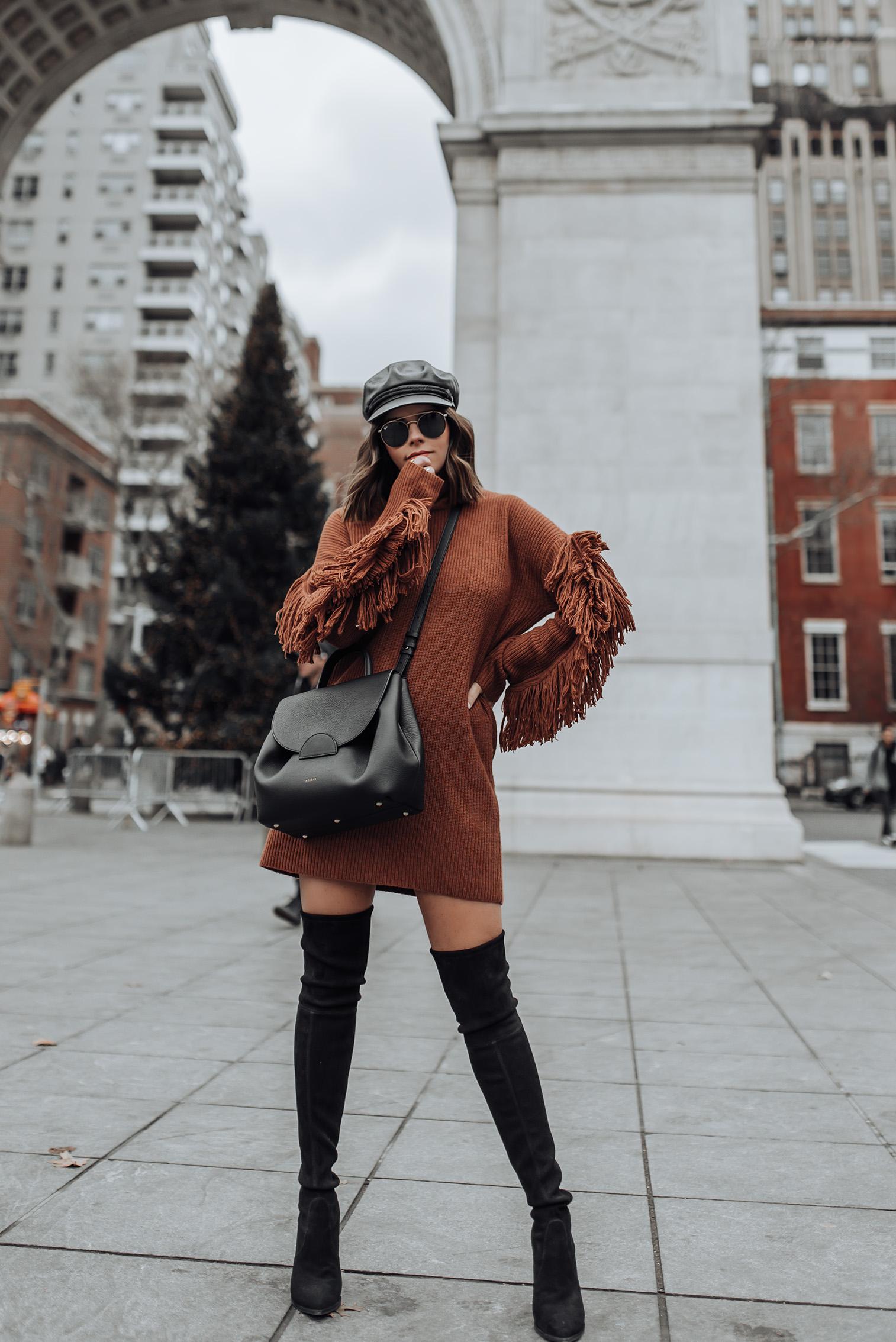 Tiffany Jais fashion and lifestyle blogger of Flaunt and Center | NYC fashion blogger | Fringe sweater dress | Streetstyle blog #ootd #sweaterdress #streetstyle #minimalfashion