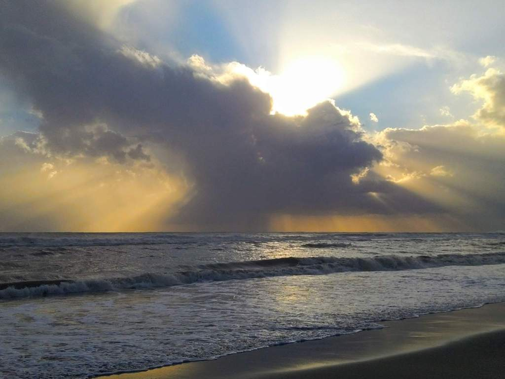 sunrays through the clouds at the beach