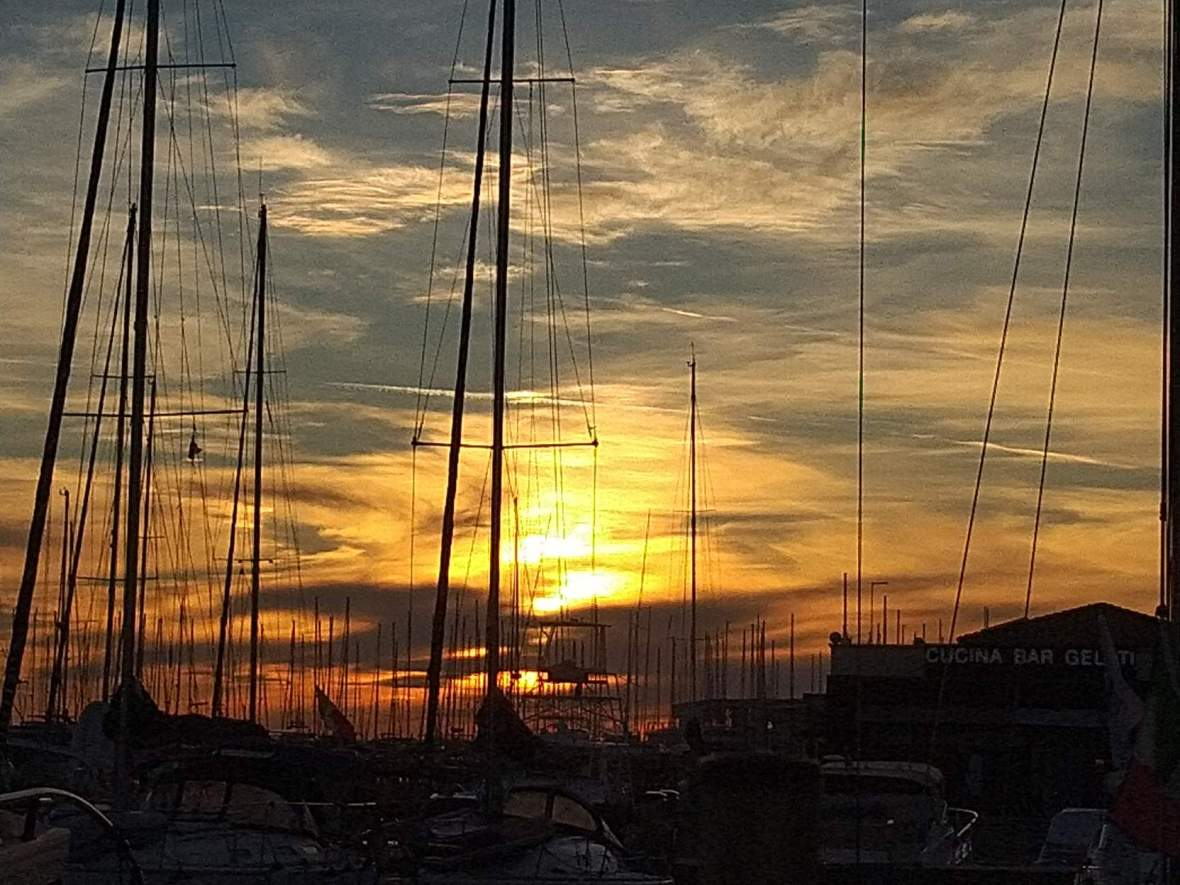 sunset at the port of Ostia, among the boats