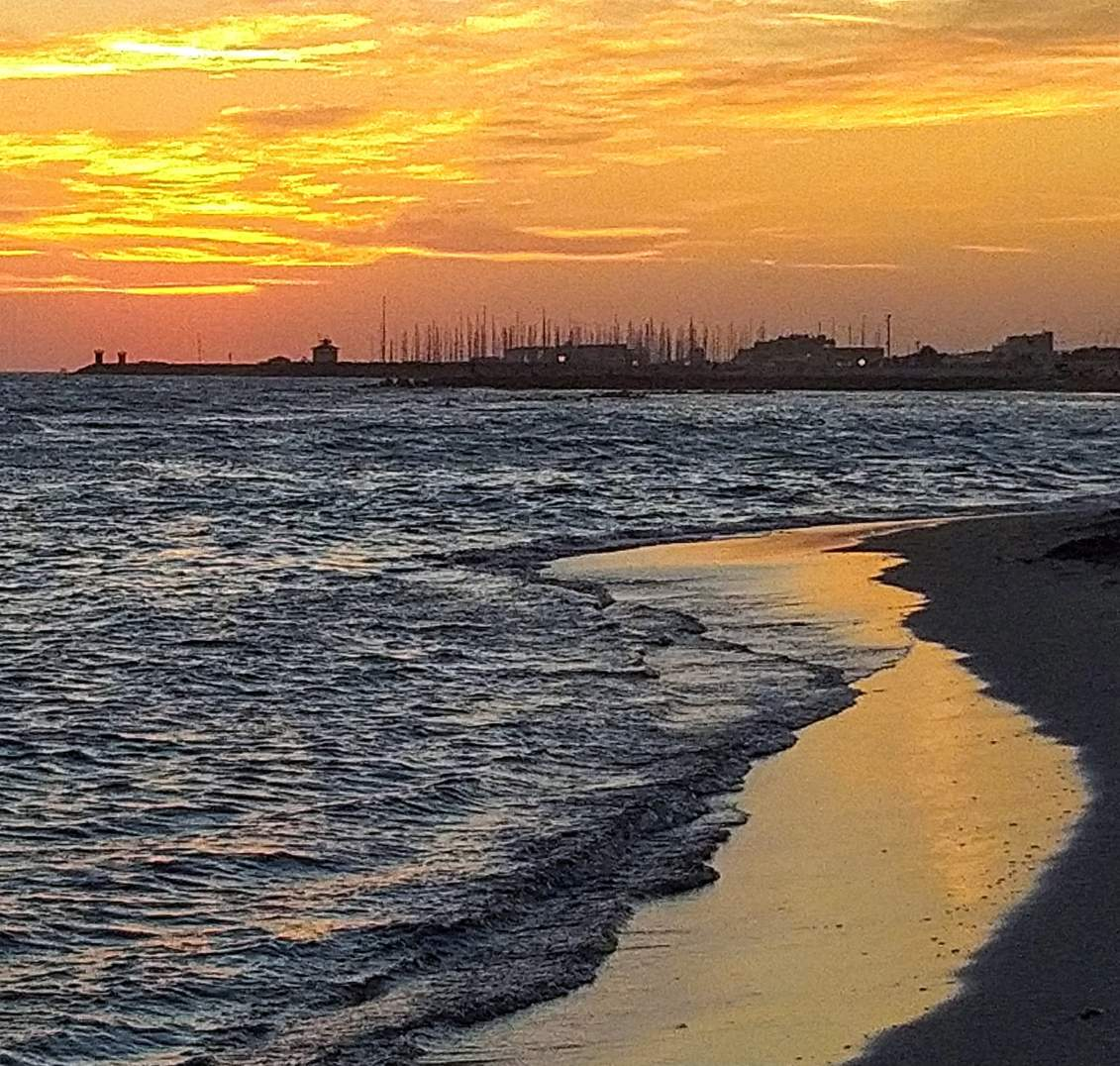 a peaceful coloured sunset at the port of Ostia