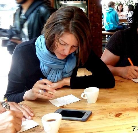 Taking notes during coffee tour in Bogota