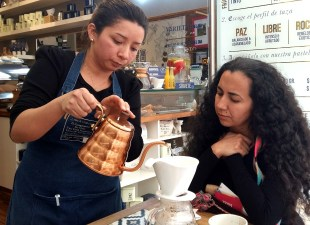 Jazmine serving coffee