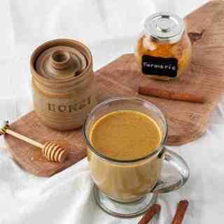 Warm Turmeric Cinnamon Milk with honey