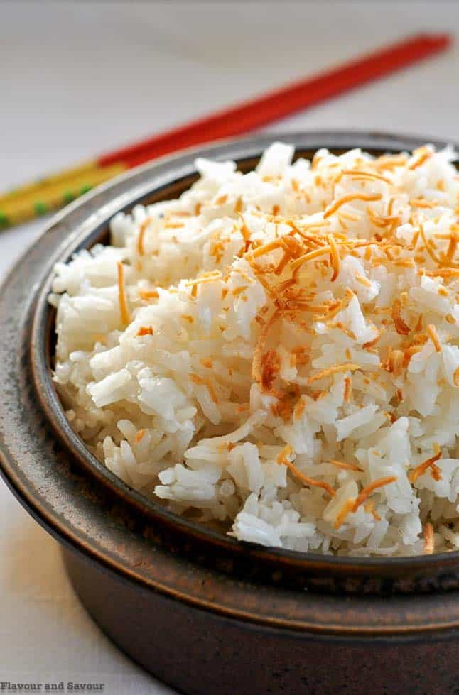 Never Fail Thai Coconut Rice in a brown stoneware bowl with chopsticks