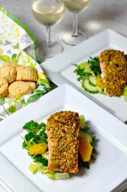 Pistachio Crusted Salmon on a citrus salad with a glass of white wine.