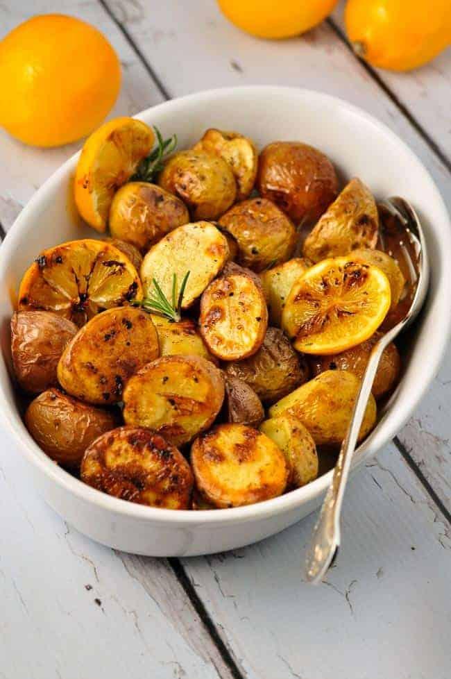 Crispy Lemon Oven-Roasted Potatoes in an oval white bowl.
