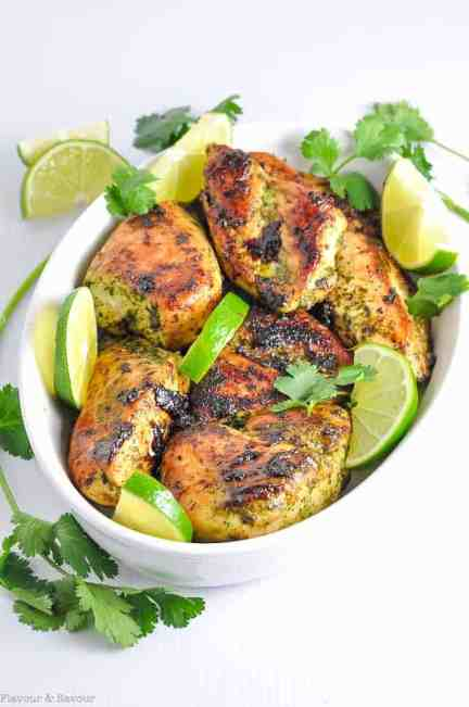 Easy Thai Baked Chicken garnished with fresh lime slices and cilantro.
