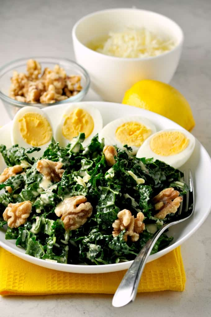 Super healthy Kale, Manchego Cheese and Walnut Salad with Eggs with a to-die-for dressing. A meal in a bowl. www.flavourandsavour.com
