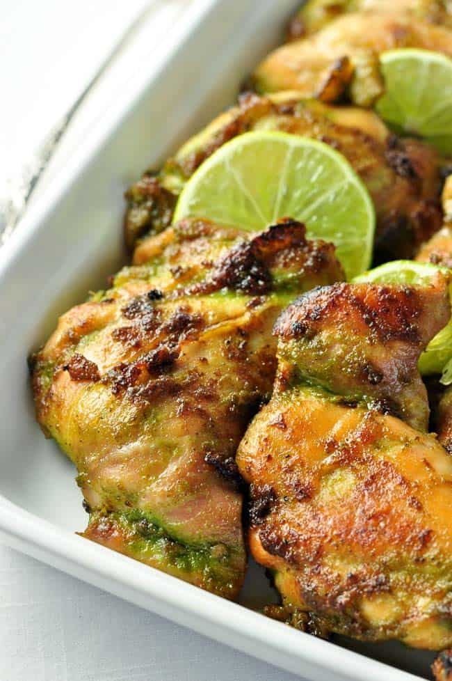 Easy Thai Baked Chicken. An easy make-ahead meal for busy nights, full of your favourite Thai flavours. The marinade for this easy recipe blends and balances those flavours harmoniously. Cilantro, jalapeño, ginger, basil, garlic and coriander all play together to produce this aromatic, slightly spicy chicken dish that leaves you wanting more. www.flavourandsavour.com