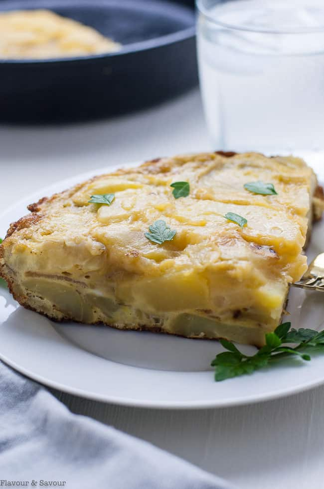 Close up view of a slice of Traditional Tortilla Española