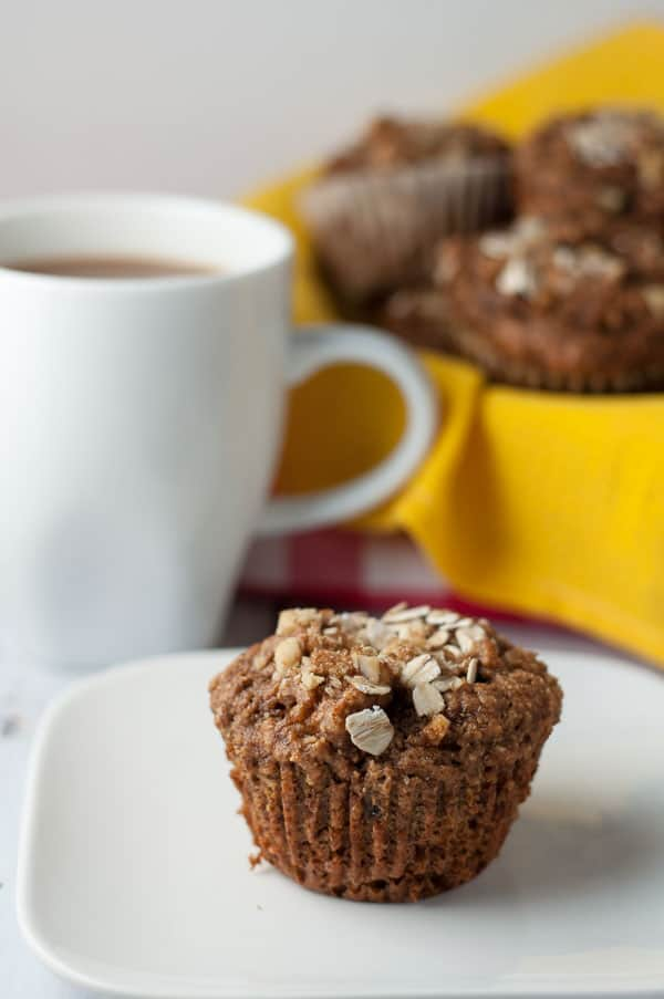 Apple Oatmeal Breakfast Muffins. Close up view of a muffin topped with oat flakes