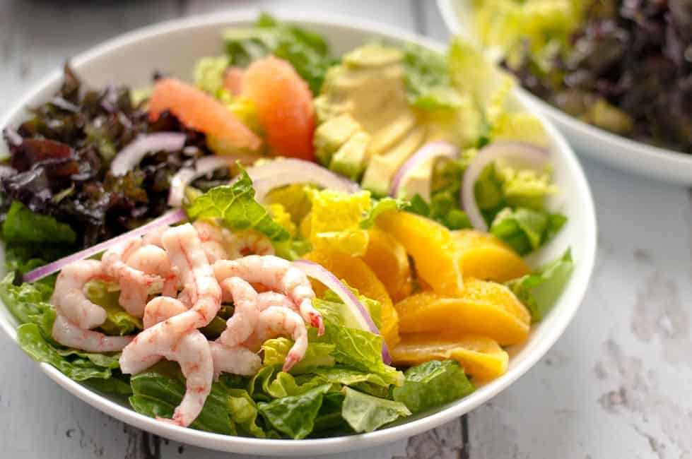 Citrus Avocado Salad with Baby Shrimp and Smoky Vinaigrette. A bright, fresh and colourful salad with oranges, grapefruit, avocado and optional shrimp on a bed of crisp romaine and red kale, all tossed with a fabulous smoky vinaigrette. |www.flavourandsavour.com