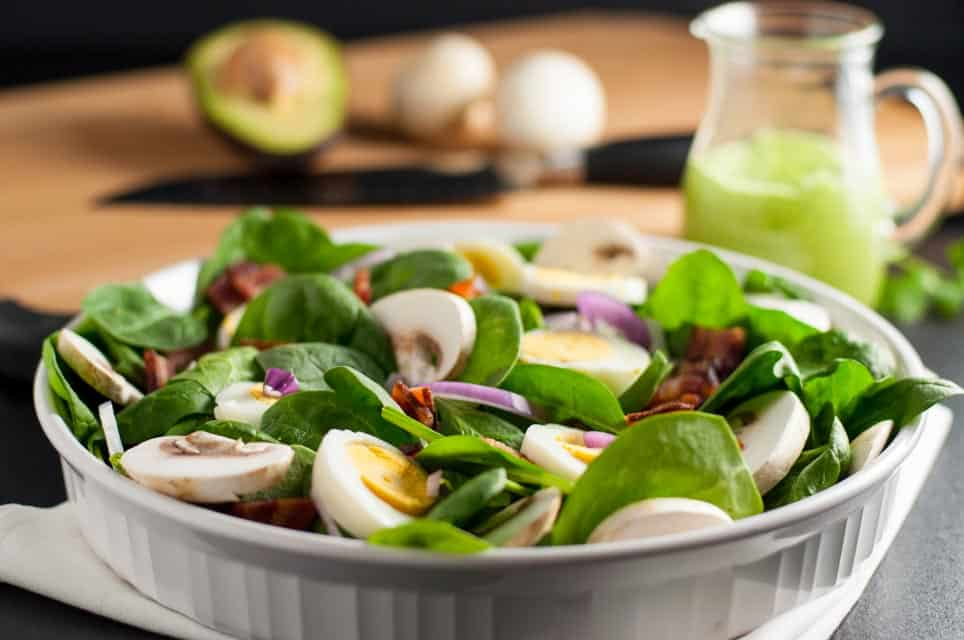 Classic Spinach Salad with Creamy Avocado Dressing. Love spinach salad but hate the high-fat buttermilk dressing? Try this updated paleo spinach salad with creamy dairy-free avocado dressing. One of 6 Tasty Healthy Winter Salads from Flavour and Savour.