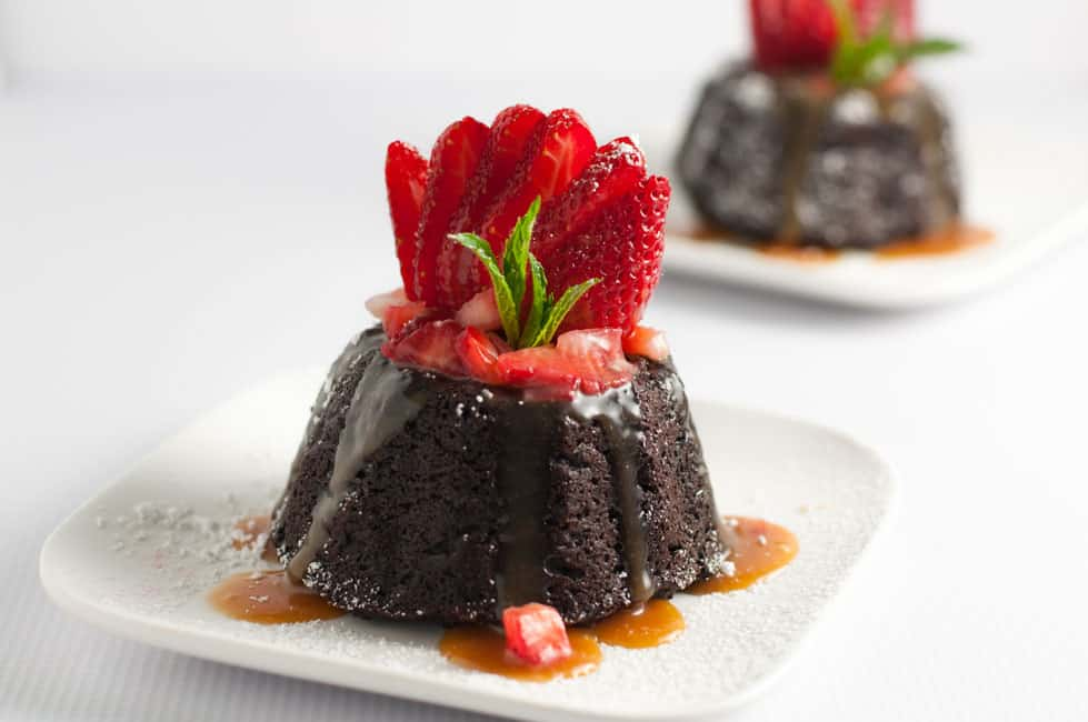 Gluten-free and dairy-free Chocolate Quinoa Mini Bundt Cakes with fresh strawberries and paleo caramel sauce. Decadent and delicious!