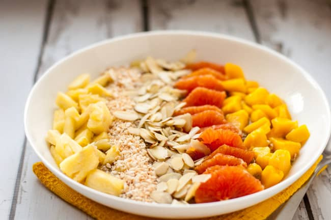 Tropical Turmeric Smoothie Bowl. Start your day with a healthy smoothie bowl made with banana, almond milk, chia, mango and pineapple. Top it with fresh fruit and nuts!