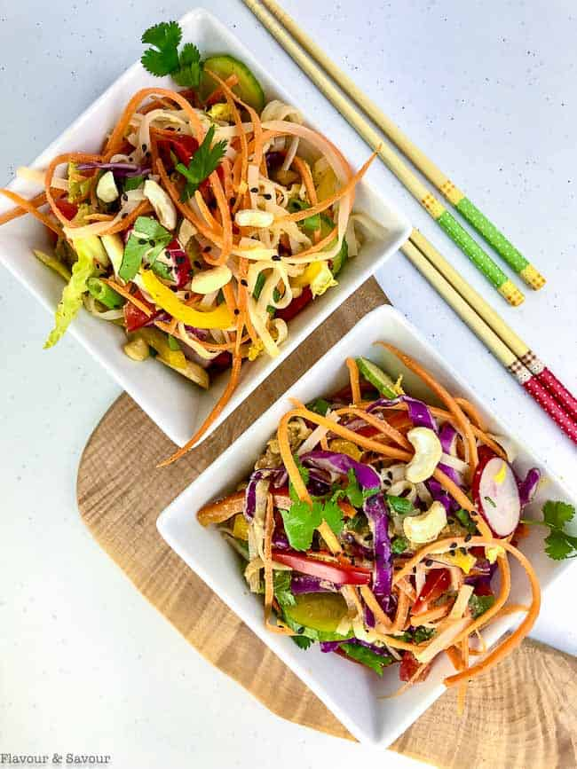 Thai Noodle Salad in two square bowls with choptsticks