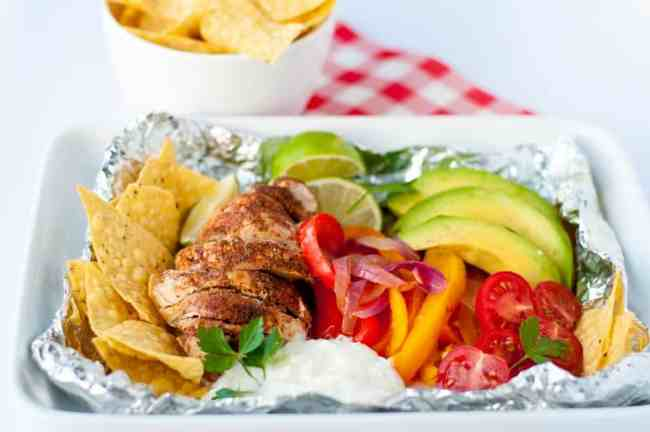 Easy Chicken Fajitas in Foil Packets. Grilling season is here! These easy to assemble chicken fajita meals can be ready for the grill or for your next campo-out. |www.flavourandsavour.com