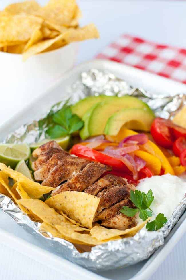 Keep calm and grill on! Easy Chicken Fajitas in Foil Packets. Grilling season is here! These easy to assemble chicken fajita meals can be ready for the grill at home or for your next camp-out.