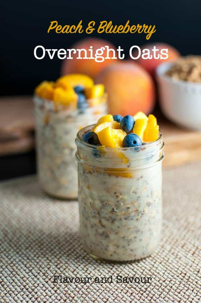 Two jars of overnight oats with peaches and blueberries on top.