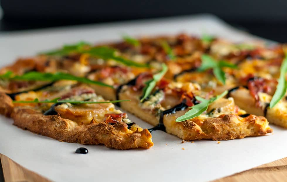 Caramelized Pear, Prosciutto and Blue Cheese Pizza. It's gluten-free! It has a unique combination of sweet pears, salty prosciutto, and sharp blue cheese that's all tied together with a drizzle of rich balsamic vinegar.  www.flavourandsavour.com