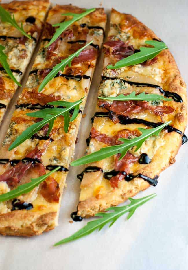 Gluten-Free Caramelized Pear Prosciutto and Blue Cheese Pizza. It has a unique combination of sweet pears, salty prosciutto, and sharp blue cheese that's all tied together with a drizzle of rich balsamic vinegar.
