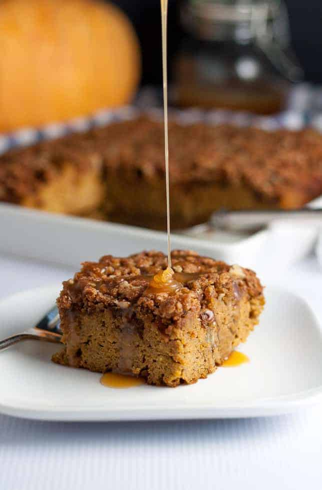 This Pumpkin Pecan Caramel Coffee Cake is topped with crunchy pecans and drizzled with caramel sauce. Made with almond flour, it's gluten-free and paleo! |www.flavourandsavour.com