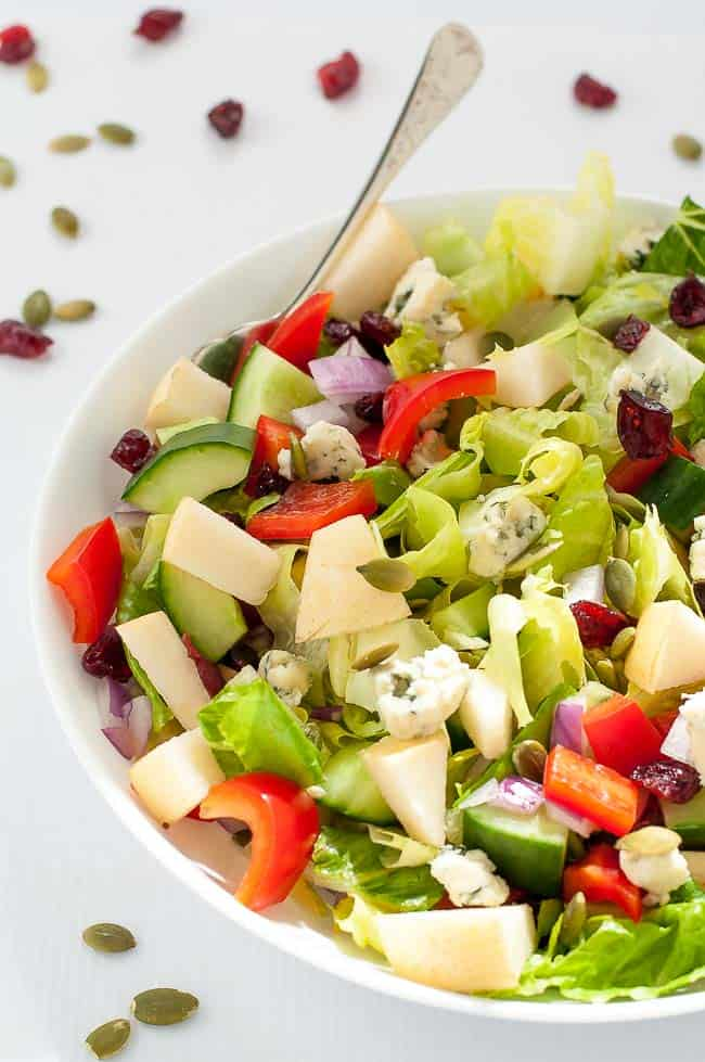 Pear and Cranberry Chopped Salad. Crisp pears and crunchy vegetables with sweet cranberries and tangy blue cheese make this colourful fall salad. A family favourite, perfect for potlucks. |www.flavourandsavour.com