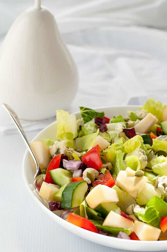 Pear and Cranberry Chopped Salad. Crisp pears and crunchy vegetables with sweet cranberries and tangy blue cheese make this colourful fall salad. A family favourite, perfect for potlucks.  www.flavourandsavour.com