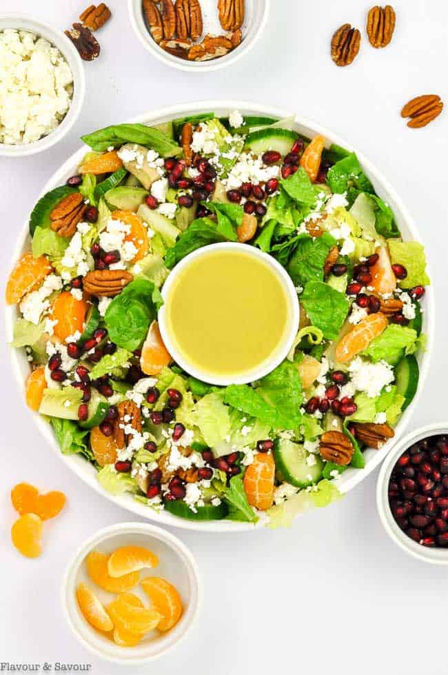 Pomegranate Mandarin Wreath Shaped Salad with ingredients in prep bowls
