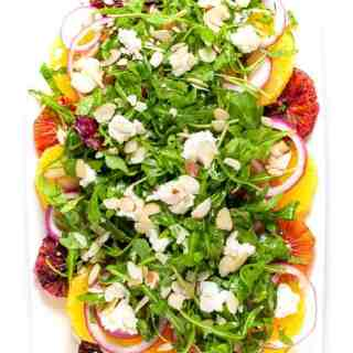 Winter Citrus Salad with Arugula and Goat Cheese. Sweet oranges, fresh mint and spicy arugula topped with tangy cheese and flaked almonds make a beautiful winter salad. |www.flavourandsavour.com