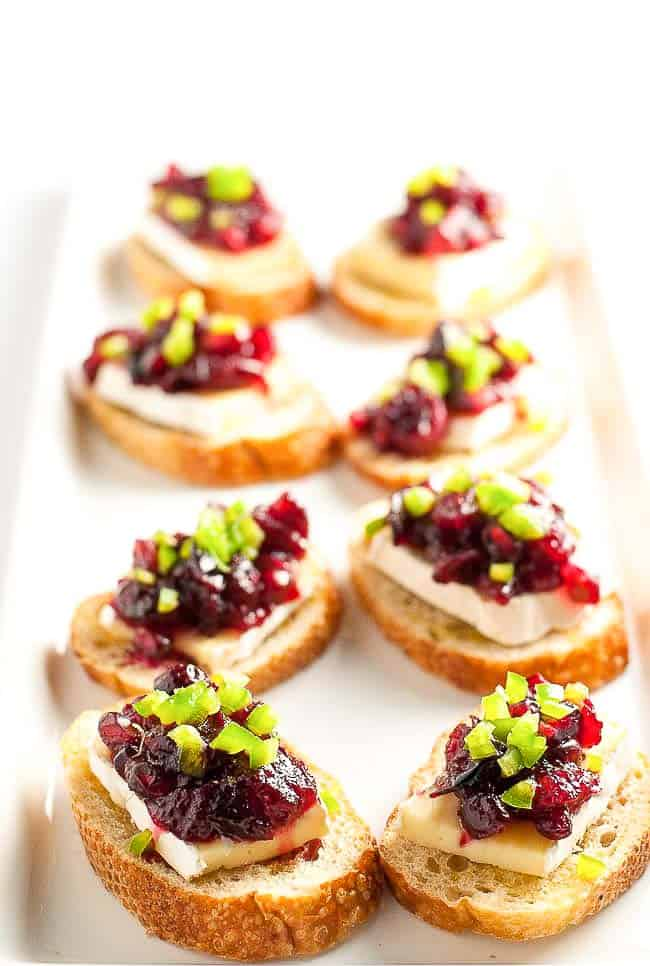 These Cranberry Jalapeño Brie Crostini Appetizers add a festive touch to your party and they're a great way to use leftover cranberry sauce!