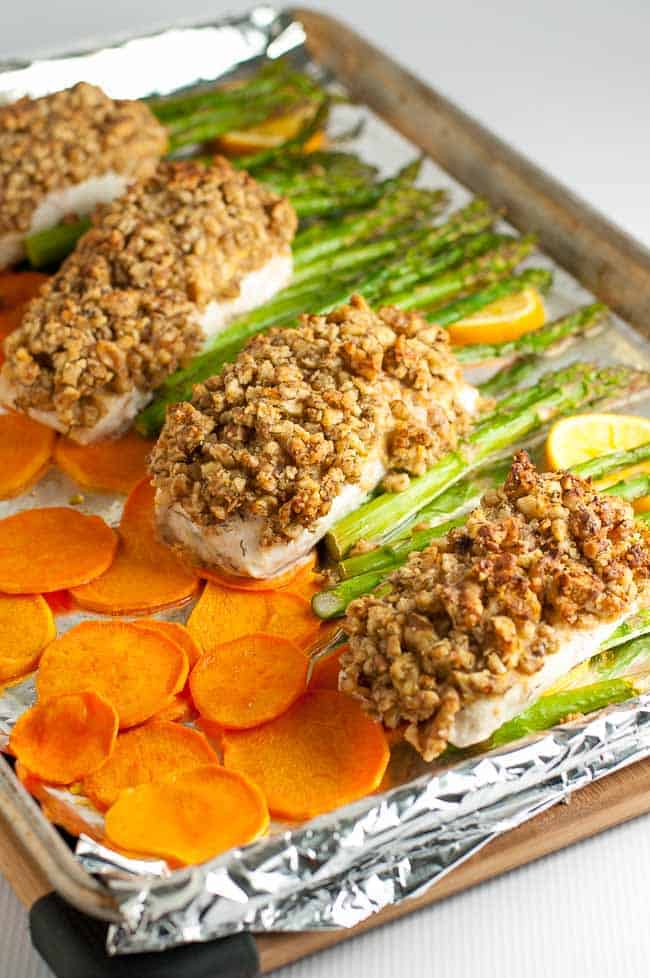 Maple Walnut Crusted Sheet Pan Halibut with crispy sweet potato chips and asparagus.