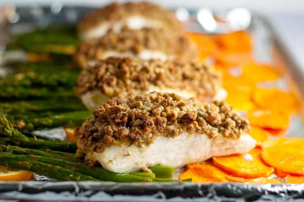 Maple Walnut Crusted Sheet Pan Halibut with crispy sweet potato chips and asparagus. A one-pan paleo meal that cooks in only 10 minutes.  www.flavourandsavour.com