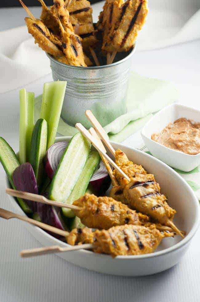 This Simple Singapore Chicken Satay with Peanut Dipping Sauce makes a great appetizer or a light meal, when served with some crunchy veggies. It's crisp and spicy and it's a perfect choice for a barbecue, a party or a simple weeknight meal. It's an easy meal that you can cook on either an indoor or outdoor grill. |www.flavourandsavour.com
