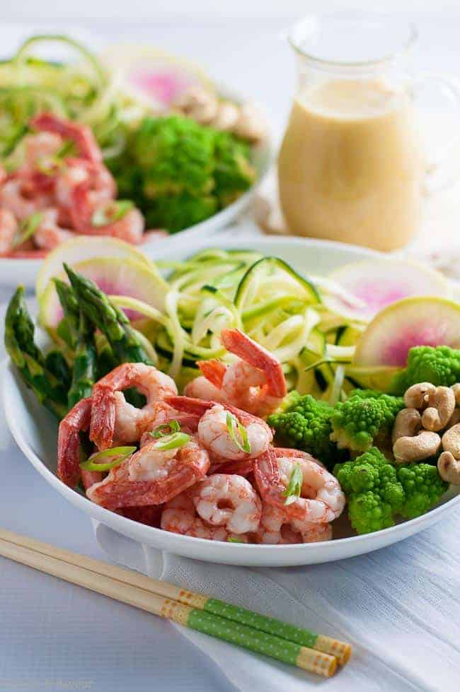 Grilled shrimp, raw zucchini noodles and crisp vegetables all drizzled with an intensely flavourful sesame miso vinaigrette make this Fresh Veggie and Grilled Shrimp Zoodle Bowl a nutritious lunch or a light dinner