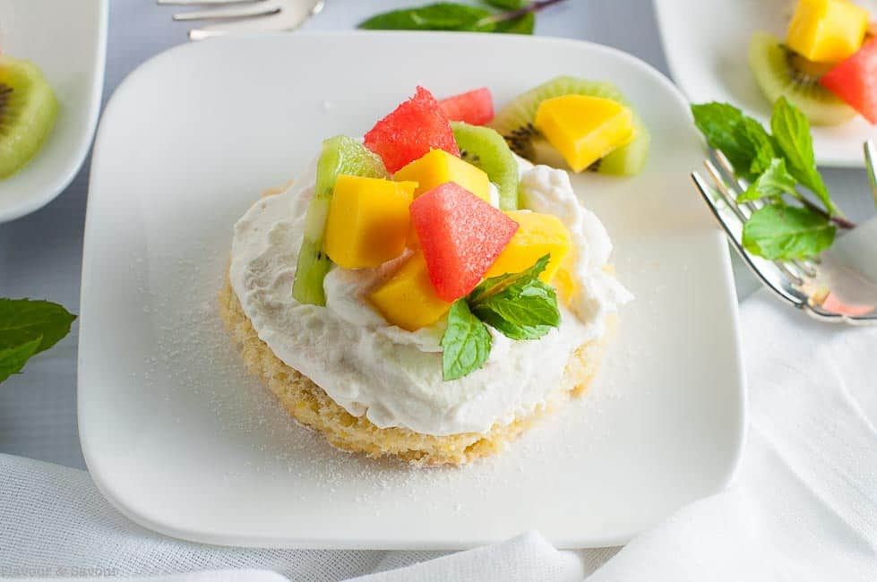 Here's a Gluten Free Lemon Fruit Flan in mini size! Individual lemon cakes topped with whipped cream and fresh fruit make a dessert that's just enough!