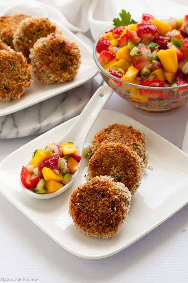 Tex-Mex Crab Cakes on a plate with a bowl of Strawberry Mango Salsa