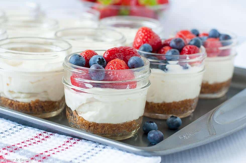 Mini Mason jar no-bake cheesecake made and served in tiny jars make an ideal dessert for a picnic, for camping, or as a fun treat for kids. Quick and easy.