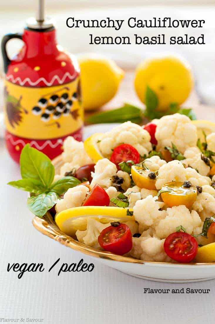 This Cauliflower Lemon Basil Salad features fresh crunchy cauliflower and sweet cherry tomatoes tossed with fresh basil, toasted capers and a light lemon vinaigrette. #cherrytomatoes #cauliflower #basil #capers #paleo #vegan #flavourandsavour