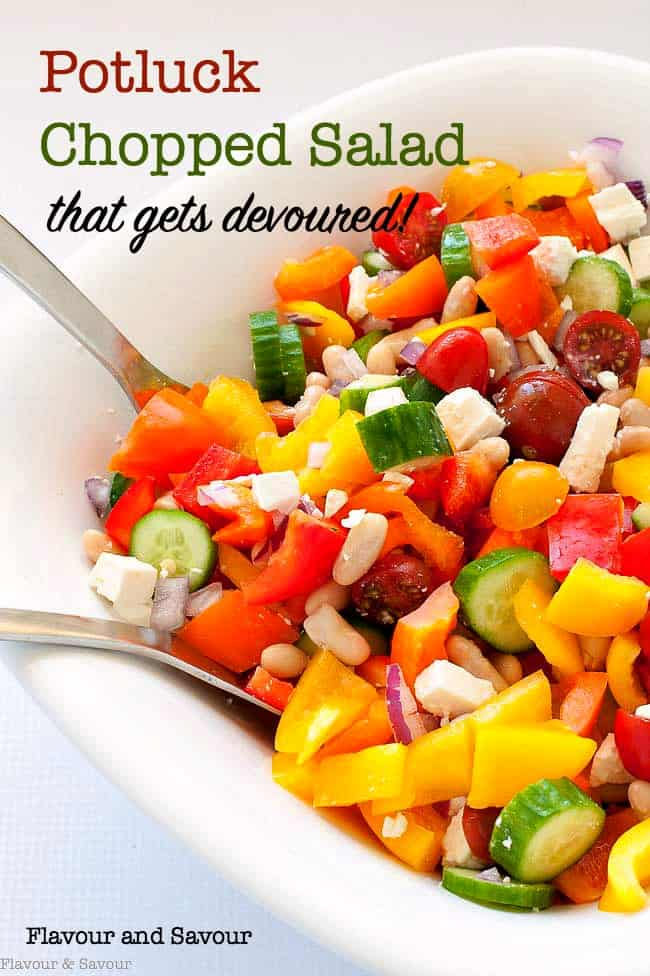 This colourful Mediterranean Chopped Salad recipe is easy to adapt to your family's tastes. Fresh peppers, cucumbers tomatoes, onions, beans and feta cheese make it a popular choice for potlucks or family gatherings. #Italian #salad #Mediterranean #Greek #whitebeans #cannellini #beans #flavourandsavour
