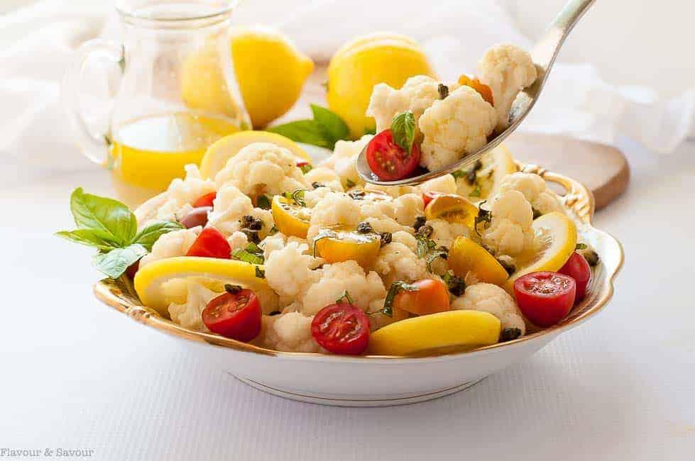 Taking a spoonful of Cauliflower Lemon Basil Salad