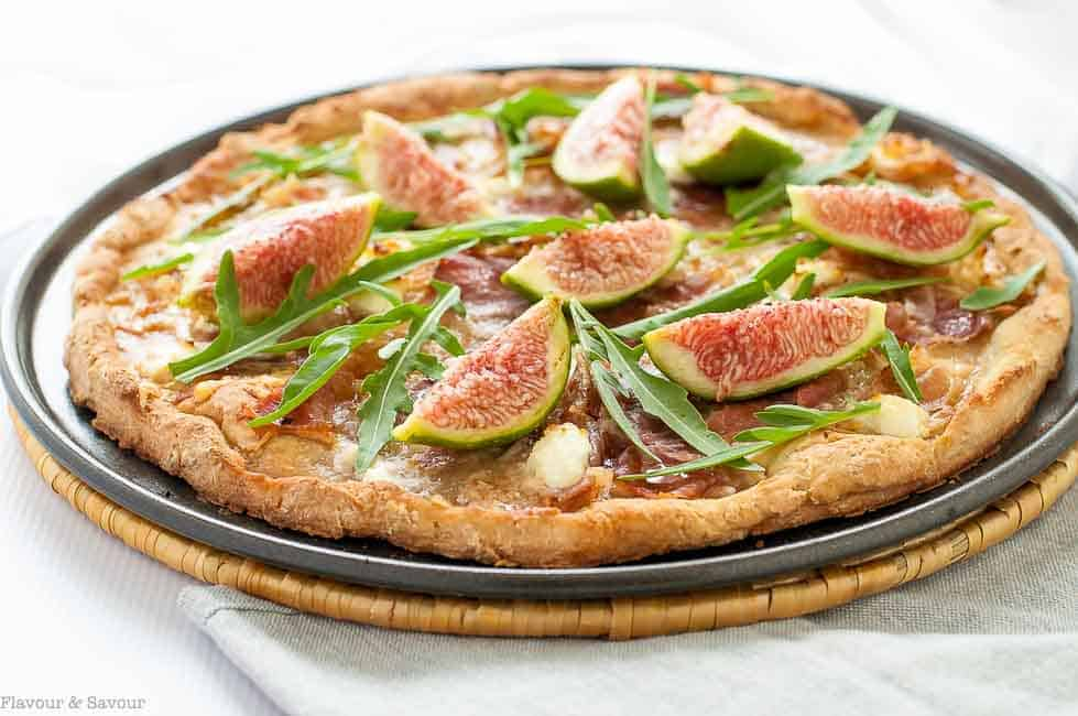 It's salty, sweet, and peppery, all on a cheesy crust! This Fresh Fig, Prosciutto and Arugula Pizza is artisan pizza at it best. Use your favourite crust!
