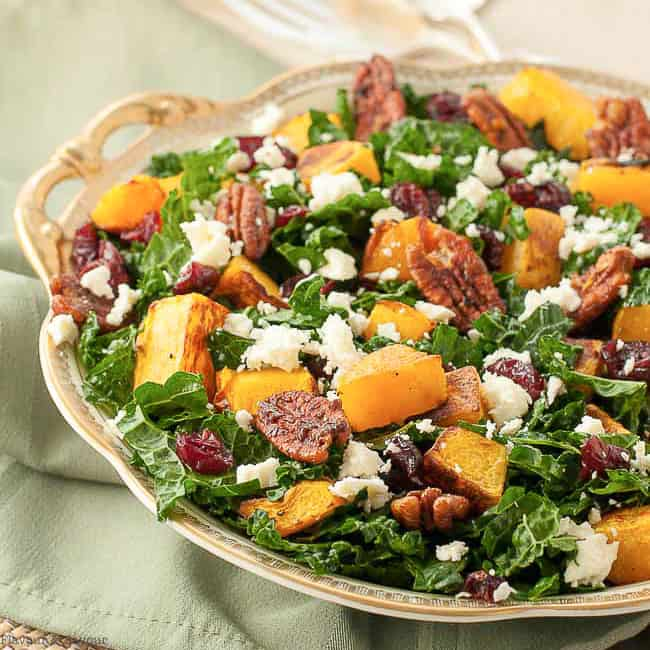 Butternut Squash Salad with Cranberries and Feta in a gold rimmed bowl