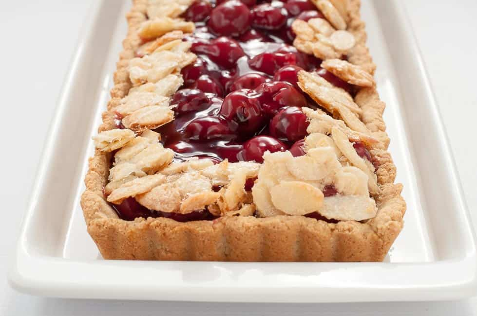 This Sour Cherry Almond Tart is gluten-free, it's just sweet enough, and it's an easy dessert to make for your next party!|www.flavourandsavour.com