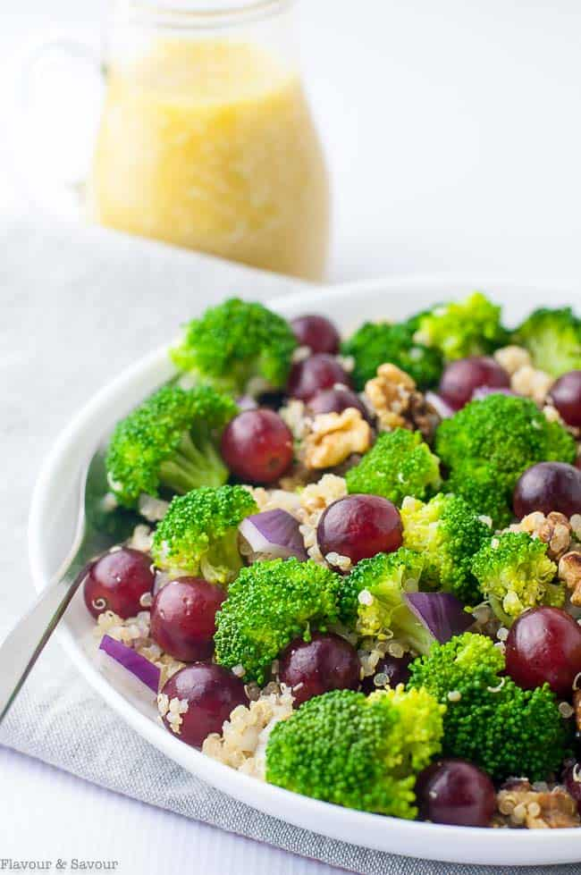 A perfect potluck salad, this Broccoli Quinoa Salad with Sesame Miso Dressing is an updated and healthier version of the traditional broccoli salad. Made with nutritious quinoa, tender crisp broccoli, sweet red grapes and walnuts, it's tossed with a to-die-for Sesame Miso Dressing. #potluck #howtoblanch #broccoli #quinoa #grapes #sesame #miso