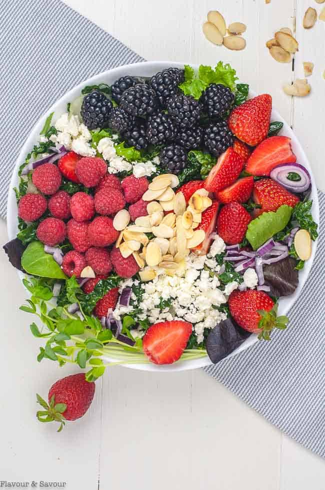 Overhead View of Triple Berry Mixed Green Salad with raspberries, blackberries, strawberries, feta and almonds