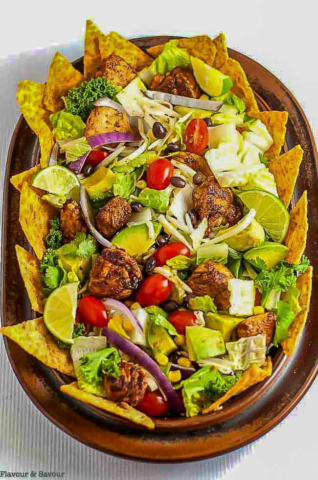 Skinny Chopped Chicken Taco Salad on a brown platter