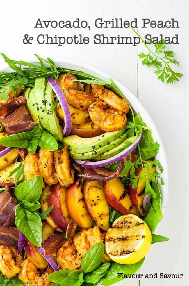 A summery dinner salad with bold flavours! This Avocado Grilled Peach Chipotle Shrimp Salad combines grilled sweet peaches, creamy avocado, spicy shrimp and smoky bacon, all on a bed of garden fresh greens. Topped with a peach dressing, this is summertime dining at its best! #peachsalad #shrimpsalad #chipotle #avocado #peaches #paleo #glutenfree #whole30