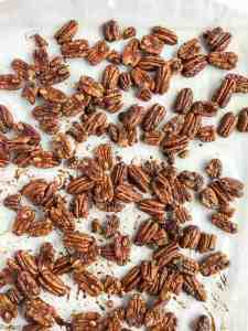 Low-Carb Pumpkin Spice Roasted Pecans out of the oven on a baking sheet